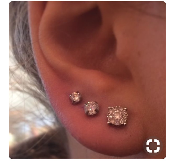 Три дырки в ушах